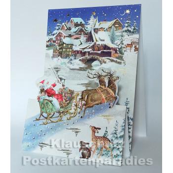 Aufstellkarte von ActeTre mit Weihnachtsmann und Schlitten