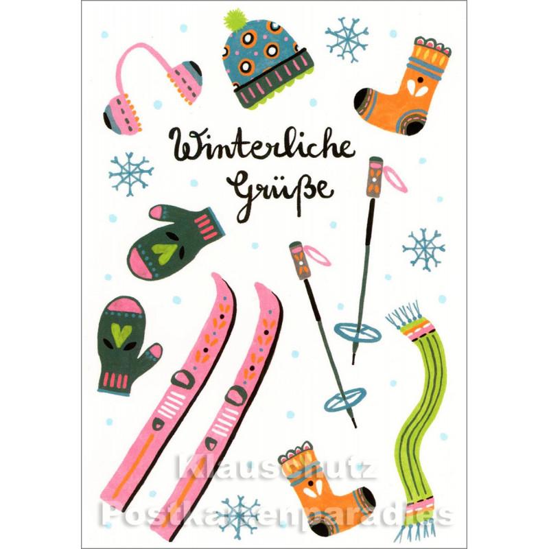Weihnachtskarte Taurus mit Skiern und Winterkleidung | Winterliche Grüße