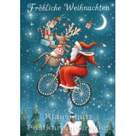 Weihnachtskarte Taurus | Weihnachtsmann fliegt auf Fahrrad durch die Nacht