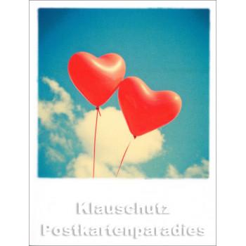 Taurus Mini-Polacard mit roten Luftballons