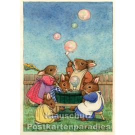 Hasenfamilie macht Seifenblasen   Taurus Kinder Postkarte